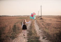 Teenager balloons in summer field Stock Image