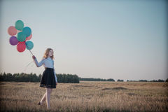 Teenager balloons in summer field Stock Photos