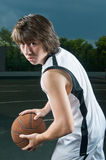 Teenager with basketball royalty free stock photo