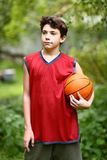Teenager basketball palyer training with ball stock photography