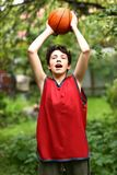 Teenager basketball palyer training with ball royalty free stock image