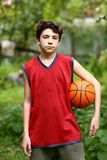 Teenager basketball palyer training with ball stock photo