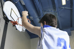 Teenager basketball player play his favorite sport Stock Photo