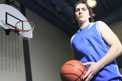 Teenager basketball player play his favorite sport Royalty Free Stock Photography