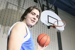 Teenager basketball player play his favorite sport Stock Photos