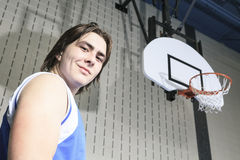 Teenager basketball player play his favorite sport Royalty Free Stock Images