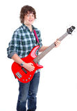 Teenager on Bass guitar. Photograph showing male teenager on guitar isolated Stock Photo