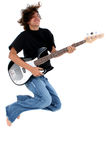 Teenager with bass guitar. Long haired multi-racial teenager jumping in air playing bass guitar, isolated on white background Stock Image