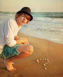 Teenager on the beach. Young guy sitting on the beach Royalty Free Stock Images