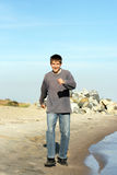 Teenager on beach. Happy teenager running on the beach Stock Image