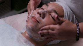 Teenager in beauty clinic. Male client gets facial cosmetology procedure in beauty salon. Medical face skin acne cleaning. Close-u. Teenager in beauty clinic stock footage