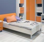 Teenager Bedroom. Orange Teenager Sleeping and Learning Room Stock Photography