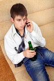 Teenager with a Beer and Cellphone Stock Photography