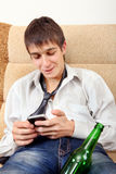 Teenager with a Beer and Cellphone Stock Photos