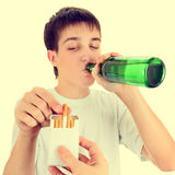 Teenager with a Beer and Cigarette Stock Images