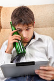 Teenager with a Beer and Tablet Stock Photos
