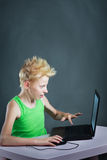 Teenager behind a computer Stock Images