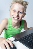 Teenager behind a computer Royalty Free Stock Images