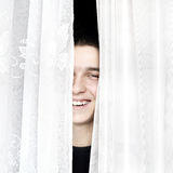 Teenager behind Curtain Royalty Free Stock Photos
