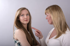Teenager being told off by mother Royalty Free Stock Photography