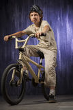 Teenager on a bicycle on a background of industrial Royalty Free Stock Photo