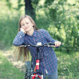 Teenager with a bicycle Stock Images