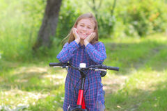 Teenager with a bicycle Royalty Free Stock Photos
