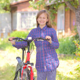 Teenager with a bicycle Royalty Free Stock Photography