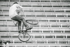 Teenager on a bicycle in a high jump Royalty Free Stock Image