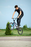 Teenager on a bicycle Stock Images