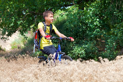 Teenager on a bicycle traveling in the forest Royalty Free Stock Images