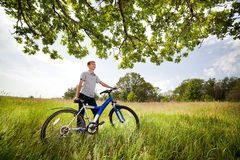 Teenager on a bicycle traveling in the forest Stock Photo