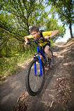 Teenager on a bicycle traveling in the forest Royalty Free Stock Photos