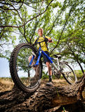 Teenager on a bicycle traveling in the woods Royalty Free Stock Photos