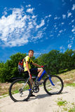 Teenager on a bicycle traveling in the woods Stock Photography