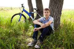 Teenager on a bicycle traveling in the woods Royalty Free Stock Photography
