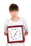 Teenager with Big Clock Royalty Free Stock Photos