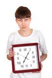 Teenager with Big Clock Royalty Free Stock Photos