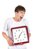 Teenager with Big Clock. Tired Teenager Yawning and holding Big Clock Isolated on the White Background Royalty Free Stock Images