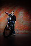 Teenager on bike stock images