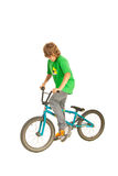 Teenager on the bike. Teenager boy on the bike isolated on white background Royalty Free Stock Photography