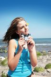 Teenager with binocular. Pretty teenager on the beach by a nice summer day having binocular in hands stock photos