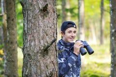 Teenager with binoculars Stock Images
