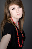 Teenager in Black Dress and Red Bead Necklace Royalty Free Stock Image