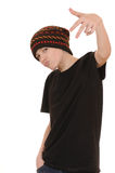 The teenager in a black vest and a hat. Isolated on white background Royalty Free Stock Images