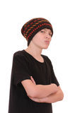 The teenager in a black vest and a hat. Isolated on white background Stock Photos