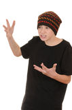 The teenager in a black vest and a hat Stock Image