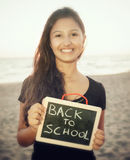 Teenager with blackboard on the beach. Concept of back to school Royalty Free Stock Images