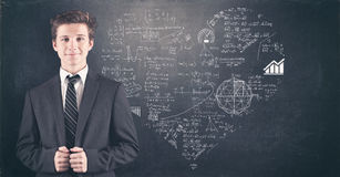 Teenager and blackboard Royalty Free Stock Photography