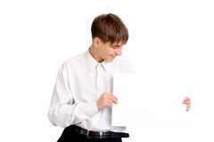 Teenager with blank paper Stock Photo